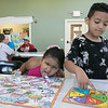 "Daily kids have fun during the Summer Eats Program at the Silver Leaf Apartments in Leominster. Having some fun playing ""Boston Ships and Ladder's"" game at the program is Abdielyz Espinal, 6, and Josiah Crespo, 6. SENTINEL & ENTERPRISE/JOHN LOVE"
