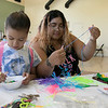 Daily kids have fun during the Summer Eats Program at the Silver Leaf Apartments in Leominster. Creating some plastic lace crafts at the program is Delaiya Rios, 8, and volunteer Katrina Montalvo. SENTINEL & ENTERPRISE/JOHN LOVE