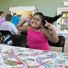 "Daily kids have fun during the Summer Eats Program at the Silver Leaf Apartments in Leominster. Having some fun playing ""Boston Ships and Ladder's"" game at the program is Abdielyz Espinal, 6. She celebrated her win. SENTINEL & ENTERPRISE/JOHN LOVE"