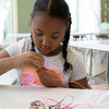 Daily kids have fun during the Summer Eats Program at the Silver Leaf Apartments in Leominster. Creating some plastic lace crafts at the program is Destiny Crespo, 8. SENTINEL & ENTERPRISE/JOHN LOVE