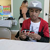 Daily kids have fun during the Summer Eats Program at the Silver Leaf Apartments in Leominster. Playing some Uno during the program is Joseph Roddriguez, 12. SENTINEL & ENTERPRISE/JOHN LOVE