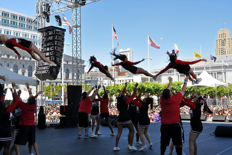 SAN FRANCISCO, CA-JUNE 24: Cheerleading sqads entertaining the crowd at the San Francisco Pride Festival in San Francisco, CA on June 24, 2012. (Photo by Clayton Call/Redferns)