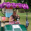 Alyssa, hitting the wall in her bedecked golf cart.