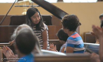 A pianist receives a round of applause after her performance as she and other musicians from across the north state take part in the Chico Summer Music Academy directed by Robert Bowman at the Bidwell Presbyterian Church in Chico, Calif. Friday July 13, 2018.  (Bill Husa -- Enterprise-Record)