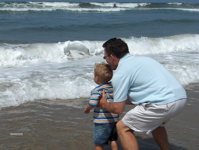 dad and finn looking at waves g