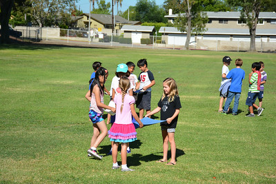 Students Practice Throwing and Catching A Water Balloon With A Towel As A Team