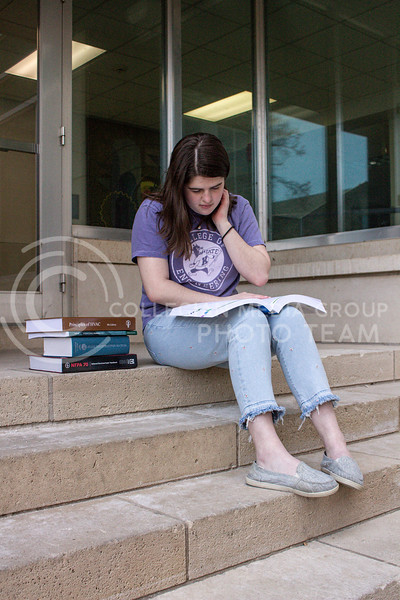 Outside of Seaton Hall, junior in Architectural Engineering Summer Savoy reads on the stairs.<br /> Photo by Macey Franko