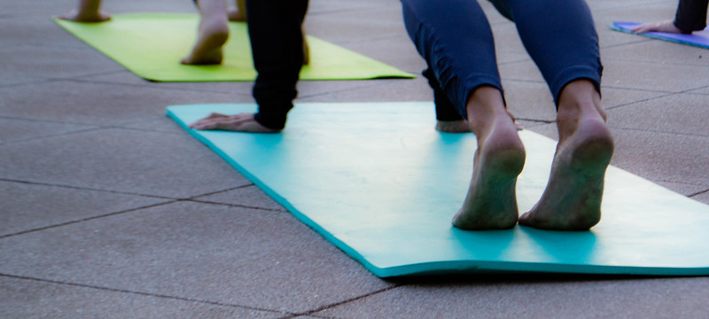 Early morning yoga-goers welcome in the longest day of the year by participating in Sunrise Solstice Yoga held on the Flint Hills Discovery Center terrace on June 21, 2018. (Madison Jahnke   Collegian Media Group)