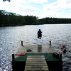 Riley Butterfield cannonballing into Scituate Pond in York Maine .