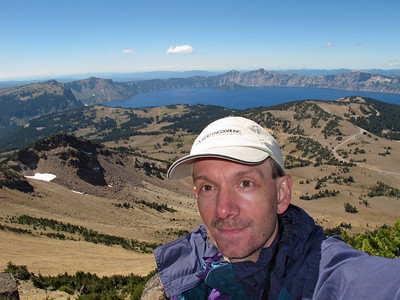 Blast from the past: on the summit of Mt Scott, which at 8,934 ft (2,723 m)  is the highest point in the Crater Lake National Park.. This was taken during our road trip with my parents in August 2010. This is an easy-moderate trail (4.5 miles round trip, 1325 feet elevation gain,  should not take more than 3 hours when there is no snow). The high altitude of the entire trail may make it not as easy as it should be if one drives up to the Crater Lake from the sea level and hikes on the same day. Note the Micro Encoder hat!