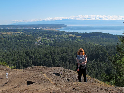 On Goose Rock. Oak Harbor is in the background. The Olympics are covered with some clouds on the horizon.