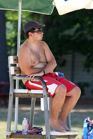 Lifeguard Nick Blood, 22, watches over the beach at Sandy Pond in Ayer for his seventh year on Monday. SUN/JOHN LOVE