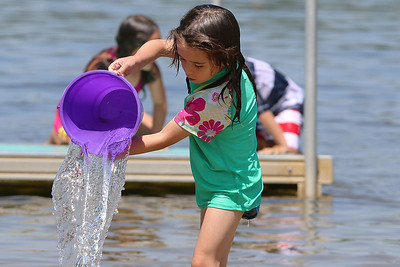 Victoria Januskiewicz, 5, of Ayer plays in the water at Sandy Pond  on Monday afternoon. SUN/JOHN LOVE