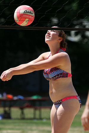 Kelsie McAllister, 16, of Ayer had some fun playing volleyball with friends at Sandy Pond on Monday. SUN/JOHN LOVE