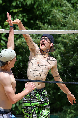 Edward Ayer, 16, and Jared Simmons, 17 ,in white hat,  both of Ayer, had fun playing volleyball with friends at Sandy Pond on Monday. SUN/JOHN LOVE