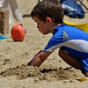 Caleb Janjuskiewicz, 3, of Ayer plays in the sand at Sandy Pond in Ayer on Monday afternoon. SUN/JOHN LOVE