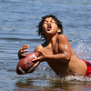 Thurman Hargrove IV of Ayer dives for a football as he plays catch with his dad at Sandy Pond in Ayer on Monday afternoon on the first day of summer 2016. SUN/JOHN LOVE