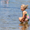 Audrey Valentine, 5, of Ayer, jumps into the water at Sandy Pond in Ayer on Monday afternoon. SUN/JOHN LOVE