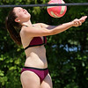 Angelina Cooper, 16, of Ayer had some fun playing volleyball with friends at Sandy Pond on Monday. SUN/JOHN LOVE