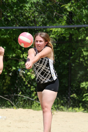 Michele Woodland, 16, of Shirley, had some fun playing volleyball with friends at Sandy Pond in Ayer on Monday. SUN/JOHN LOVE