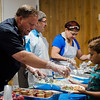 Police Chief Ernie Martineau serves salad during a luncheon to celebrate the end of summer camp at New Life Spanish Christian Church in Fitchburg on Friday, July 28, 2017. SENTINEL & ENTERPRISE / Ashley Green