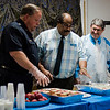 Police Chief Ernie Martineau, Pastor George Rodriguez and Mayor Stephen DiNatale serve food during a luncheon to celebrate the end of summer camp at New Life Spanish Christian Church in Fitchburg on Friday, July 28, 2017. SENTINEL & ENTERPRISE / Ashley Green