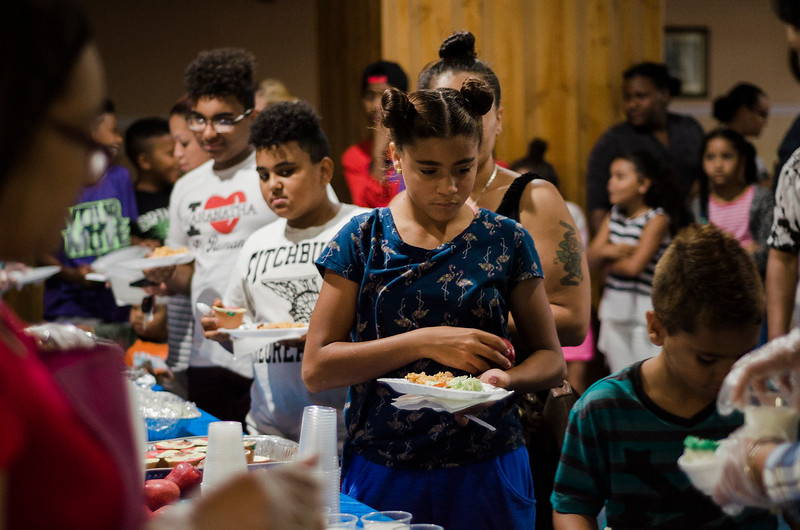 Kids line up during a luncheon to celebrate the end of summer camp at New Life Spanish Christian Church in Fitchburg on Friday, July 28, 2017. SENTINEL & ENTERPRISE / Ashley Green