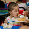 Veronica Carmona, 3, samples some rice during a luncheon to celebrate the end of summer camp at New Life Spanish Christian Church in Fitchburg on Friday, July 28, 2017. SENTINEL & ENTERPRISE / Ashley Green