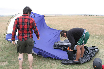 Fighting to set up the tent at Badlands National Park.