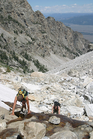 Scrambling up the boulder field onto the saddle of Middle Teton.