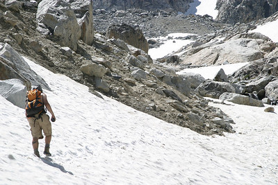 Wes crosses a snowfield on the Middle Teton ascent.  You can't see the 200 foot drop to his right.