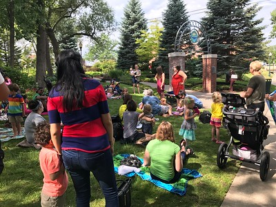 Betsy Raczkowski, left, one of two youth services librarians, presenting Storytime in the Park at the Rotary Park in downtown Rochester, just beside the Rochester Hills Public Library, where summer reading programs are emphasized for all children. Stephen Frye / Digital First Media