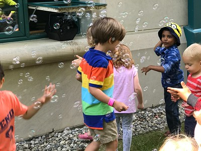 Children finish an outdoor story time at the Rochester Hills Public Library in downtown Rochester with a bubble machine. Summer reading programs vary and emphasize making reading fun. Photo by Stephen Frye / Digital First Media
