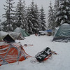 In no time our camp was up with sleeping tents, a large group tent , a dining hut (under the blue tarp) and a winter fire. <br /> Front left of picture is my Mountain Hardware EV2 tent.  3rd from left is my MSR Superfusion 3, 3 person 4 season tent.  Everyone's tents worked great in the snow.