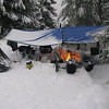 Our hut was a 3 feet deep hole with a wrap around snow bench for everyone to sit on.  For cooking we used a two burner stove and a jet boil stove.  In the middle was a fire hole for everyone to keep warm. It was the party center for eating, drinking, and chatting.