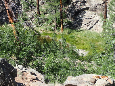 1/2 mile from trailhead and you get to the ridge of the canyon to see the first tank