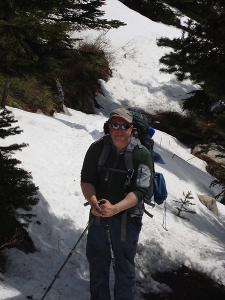Me carrying 35lbs and enjoying a sunny day hike in the snow.  Can't wait to reach our camp area.