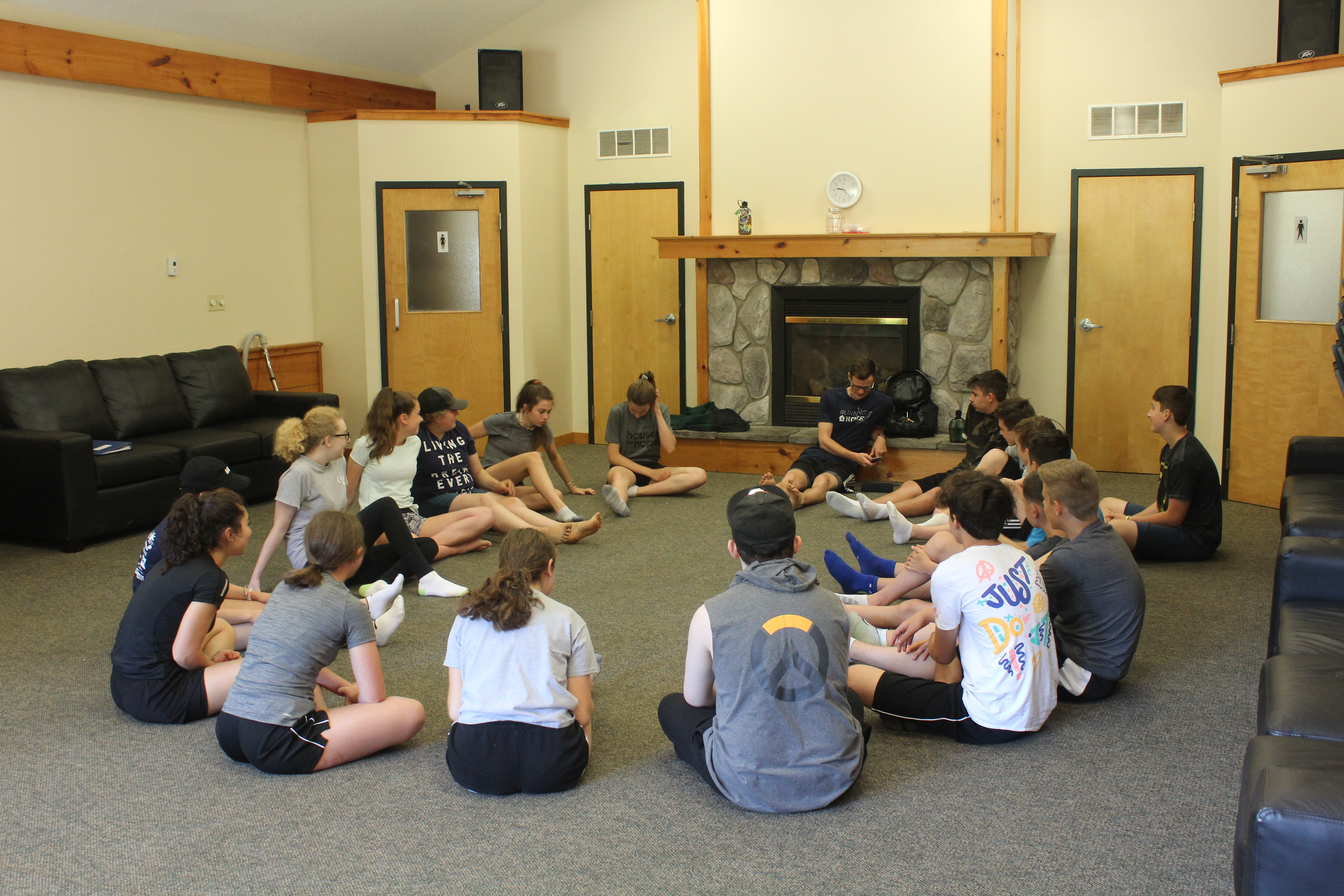 students sitting down in the hub meeting room for a lesson during Leadership Training