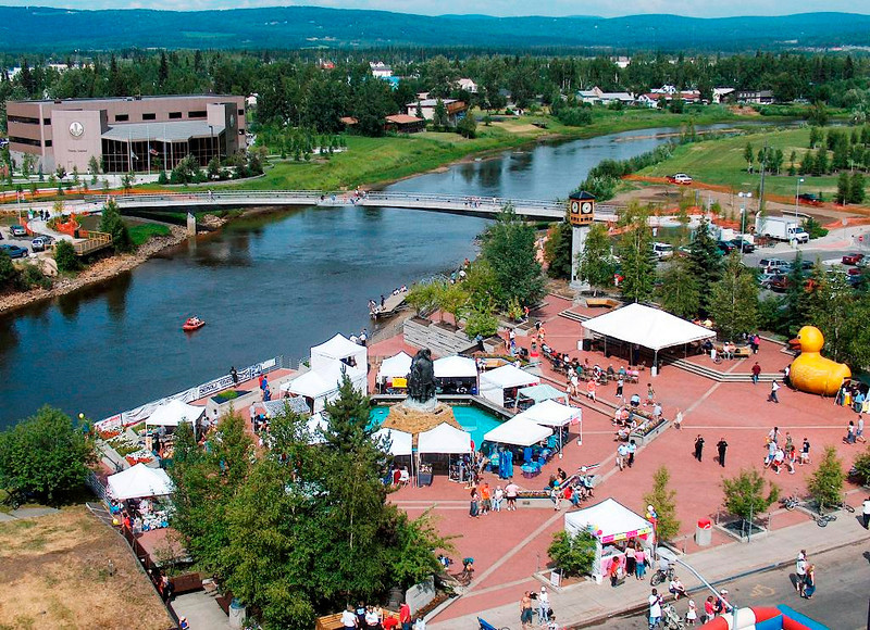 Credit: Nicholas Jacobs/FCVB<br /> <br /> An overhead view of the Centennial Footbridge crossing the Chena River during the Midnight Sun Festival in Golden Heart Plaza, downtown Fairbanks.
