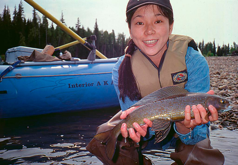Credit: Loga Ricketts - Alaska Fishing & Raft Adventures<br /> <br /> An angler shows off her Arctic Grayling catch.