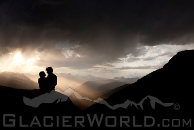 A man and woman embracing at sunset