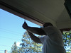 Bill doing his handyman thing--putting in hooks for the hanging baskets