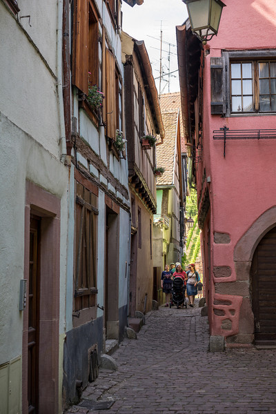 Riquewihr, France, down the narrow street of the Jewish Quarter, where the houses are decidedly less impressive than the rest of the city.