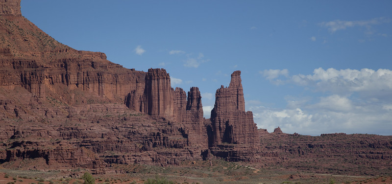 This was taken en route in the valley through which the Colorado River flows, in what is known as Castle Valley. These are known as Fisher Towers.