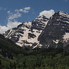 Here are the peaks known as Maroon Bells. They are all above 14,000 feet, with the vertical rise from the lake being just over 4,000 feet. The bike ride up from Aspen Highlands is 8.5 miles. This is not the steepest bike climb in the Aspen area, but it is the only one of this length which does not involve traffic of any significance. Cars are prohibited from ascending between 9 and 5 (although, some have passes as exceptions). Except for one reprieve, the ride is relentlessly uphill the entire way.