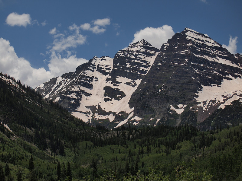 """Here is a quick view of the magnificent wilderness area of Maroon Bells. The mountains do not look """"maroon"""" in this particular light, but I will return there for a sunrise when the red-purple stone becomes quite evident. These peaks are all above 14,000 feet, with the vertical rise from the lake being just over 4,000 feet."""