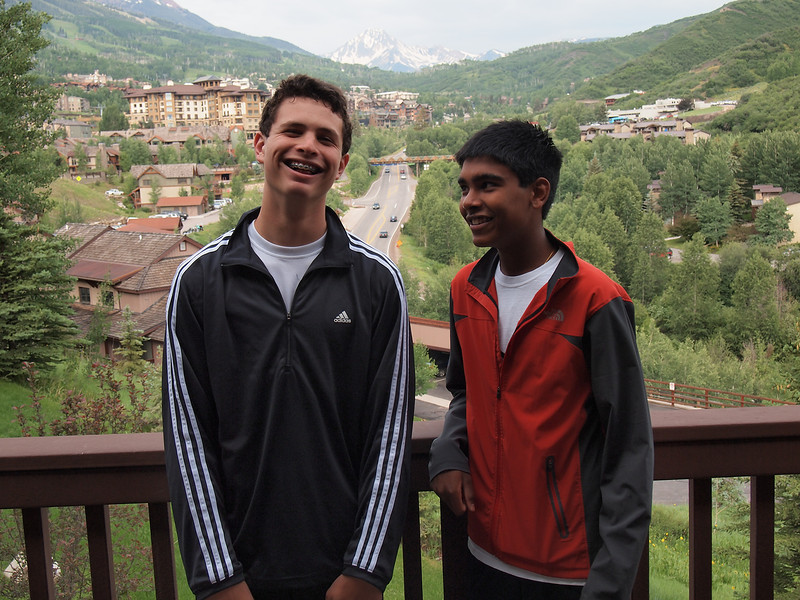 Nakul arrived on late July 5th. Here are the boys on the balcony of our July condo. Haystack Mountain is in the background.