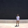 "Standing before the wall of the ""Sons of Darkness,"" part of the Dead Sea Scroll exhibit."