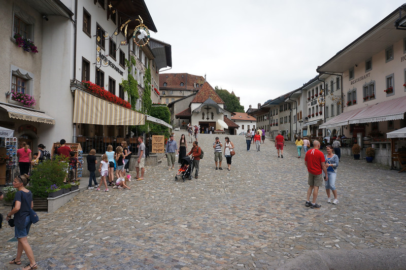 The main and really only street of the late medieval village of Gruyere. No motorized vehicles can enter the village. It is pretty much centered on tourism and promoting the cheese industry. However, they have managed to keep the kitsch to a minimum, which allows the visitor to get a real sense of what it might have been like to live their 400 years ago.