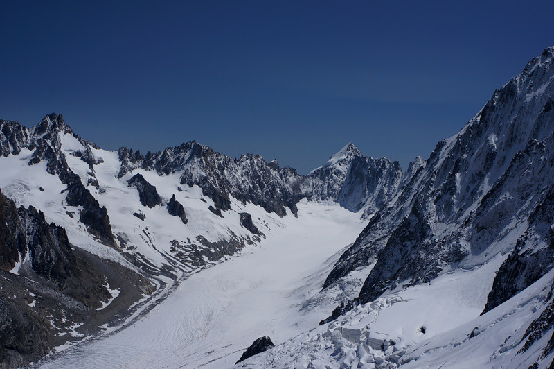 Pointy peak in center is Mount Dolent (3823m; 12,542ft). In the middle is France; behind it to the north (left, looking at the image) is Switzerland; to the south-east is Italy. Running below the peak is Glacier D'Argentiere.